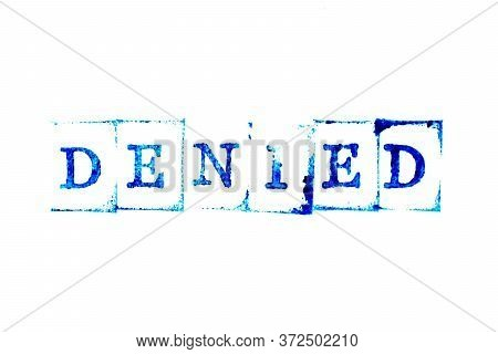 Blue Ink Of Rubber Stamp In Word Denied On White Paper Background