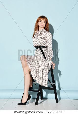 Young Smiling Sensual Red-haired Woman In Elegant Light Dress With Bow, Black Leather Belt And High