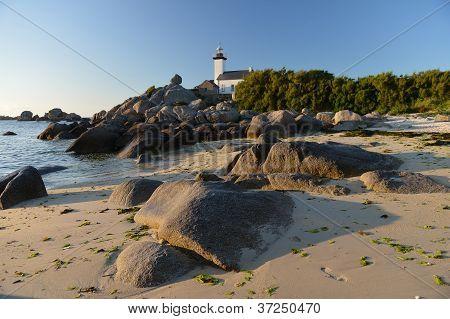 lighthouse on rocks Atlantic coast of Brittany, France