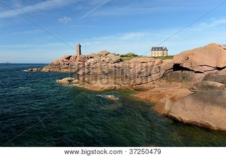 old lighthouse on the pink rocks Atlantic coast of Brittany, France
