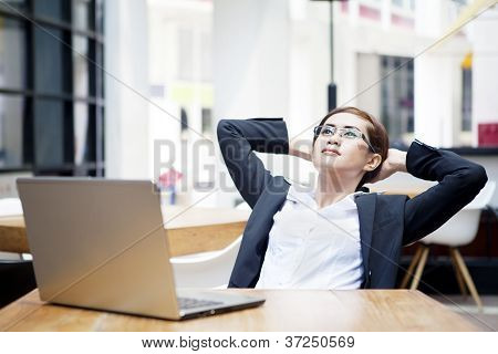 Relaxed Businesswoman At Cafe