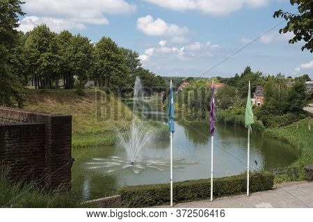 Landscape Of The Ramparts And Canals Around Hulst In The Netherlands With Fountain