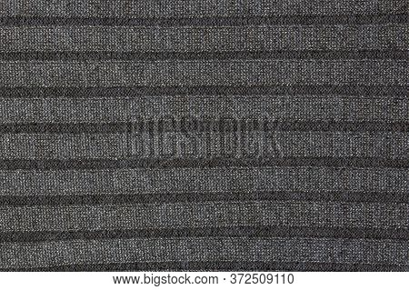Repeating Machine Knitting Texture Of Sweater. Knitted Background. Cable Knit Background Texture In
