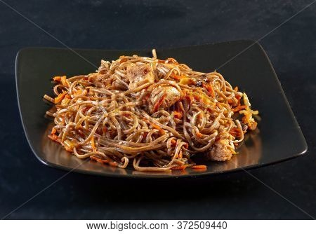 Dish Of Japanese Cuisine Japanese Asian Specialties Fried Yakisoba Noodles On A Black Ceramic Plate