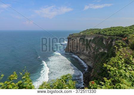 View Of Uluwatu Cliff With Pavilion And Blue Sea In Bali, Indonesia. Beautiful Scenery Of Pura Luhur