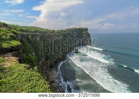 Overview Panorama Ocean Shore, Cliff. Overwhelmed Scene The Flower And Green-capped Vertical Cliff O