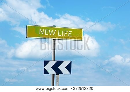 New Life. Road Sign Against A Blue Cloudy Sky. The Beginning Of A New Life. New Career.