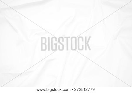White  Fabric Cloth Background Abstract With Soft Waves , Flowing Draped Cloth In Rippled Elegant Cu