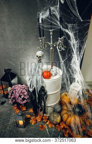 Photozone With Pumpkins, Scary Ghost With Skull And Cobweb For Halloween Party