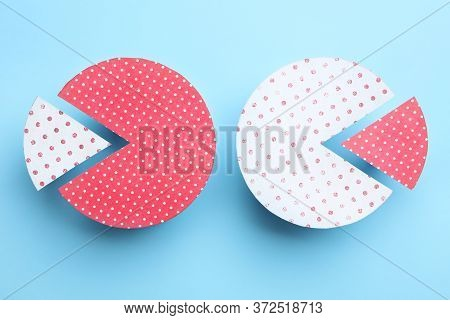 Paper Circles With Exchanged Segments On Light Blue Background, Flat Lay. Pareto Principle Concept