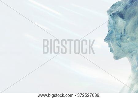 Esoteric Portrait. Spiritual Enlightenment. Blue Mist In Peaceful Woman Silhouette Double Exposition