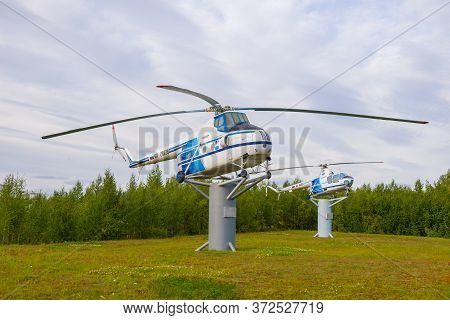 Salehard, Russia - August 29, 2019: Two Soviet Monument Helicopters (mi-4 And Mi-1) Near The Airport