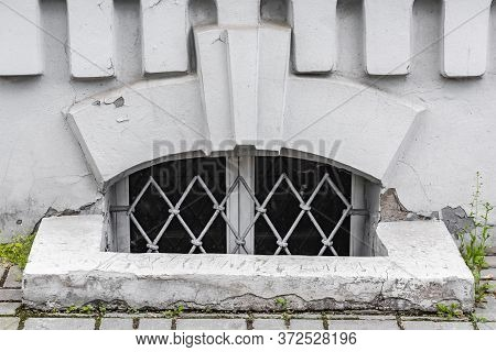 Small Window Of The Basement With Iron Bars Close Up