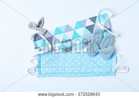 Homemade Protective Masks And Adorable Girly Hair Clips On White Background, Flat Lay. Sewing For Ch