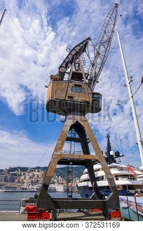 Genoa, Italy - August 20, 2019: Ancient Crane In Porto Antico Di Genova Or Old Port Of Genoa, Liguri