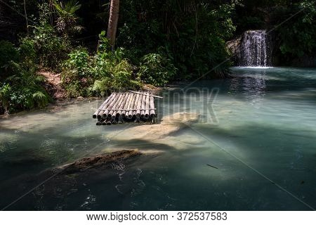 Tropical River With Turquoise Water And A Bamboo Raft. Fresh Water River And Waterfall In Tropical J