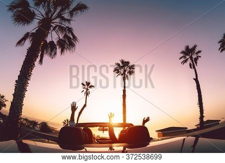 Happy Couple Having Fun During Road Trip In Convertible Car - Young Lovers Enjoying Vacation In Trop