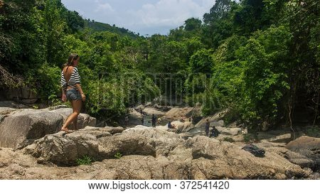 Koh Phangan, Thailand- April 19 2019: Natural Waterfall Visitors Tourists