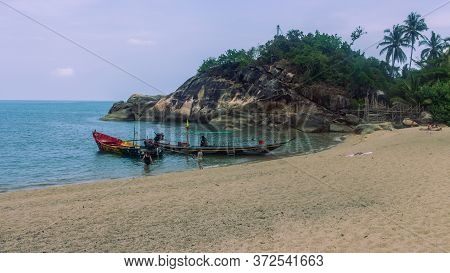 Koh Phangan, Thailand- April 19 2019: Whie Sand Beach, Traditional Long Tail Boat