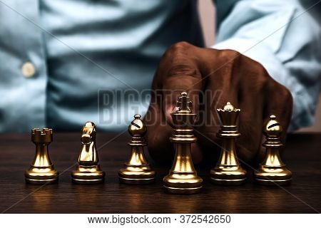 Golden Chess Team On Chess Board Concept Of Business Strategic Plan And Professional Teamwork And Ri
