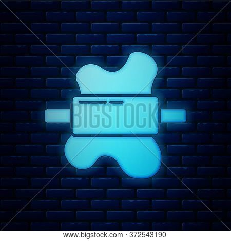 Glowing Neon Rolling Pin On Dough Icon Isolated On Brick Wall Background. Vector