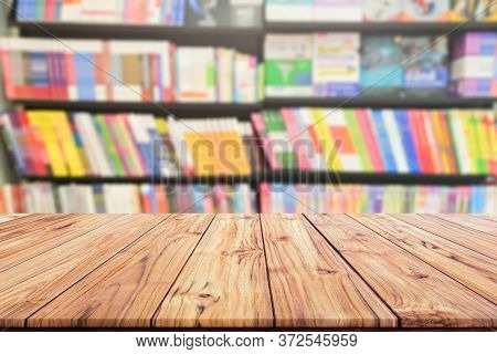 Table Top Wood Desk And Blurred Bookshelf In The Library Room, Education Background, Back To School