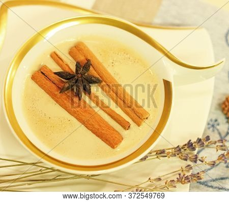Moning Coffee In Luxury White Cup With Cinnamon Sticks And Star Anise.beautiful Warm Scene Cozy Home