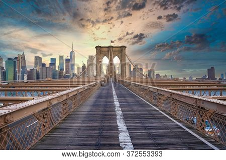 Magical Sunset View Of The Brooklyn Bridge. Empty Bridge With No People  During Lockdown In New York