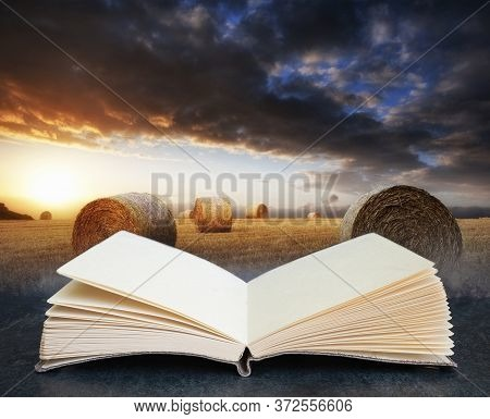 Digital Composite Concept Image Of Open Book Wth Lovely Sunset Golden Hour Landscape Of Hay Bales In