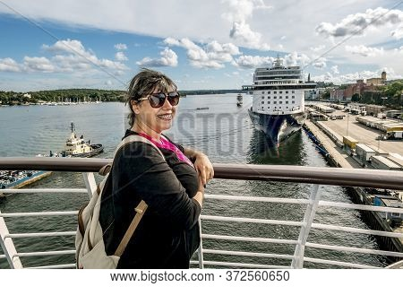 Stockholm, Sweden. 04.04.2015. A Woman Stands On The Deck Of A Ferry Sailing To The Stadsgarden Ferr
