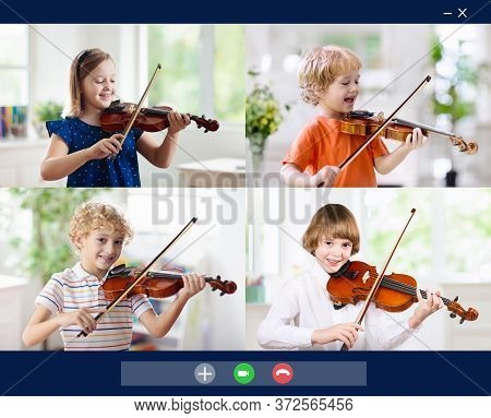 Online String Orchestra Rehearsal. Kids In Band Play Violin. Child Playing Music. Remote Learning Fr