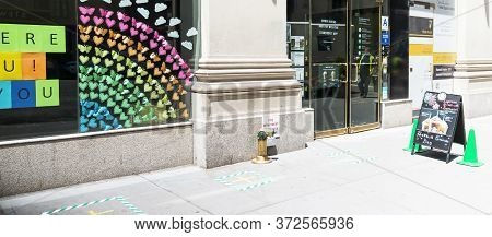 New York City, Usa - 26 May 2020: A Starbucks Has Marded The Sidewalk For Customers To Stand Six Fee