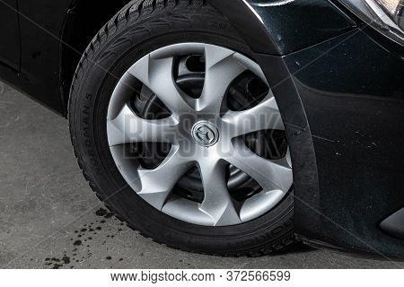 Novosibirsk/ Russia - June  03 2020: Mazda 3, Car Wheel With Alloy Wheel And New Rubber On A Car Clo