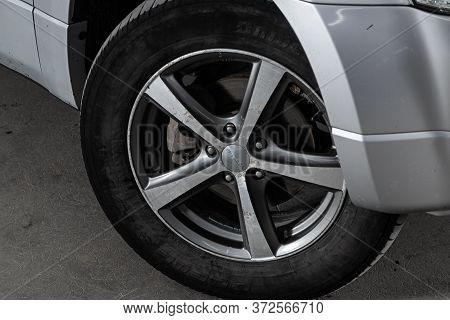 Novosibirsk/ Russia - June  03 2020:suzuki Escudo, Car Wheel With Alloy Wheel And New Rubber On A Ca