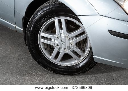 Novosibirsk/ Russia - June  10 2020: Ford Focus, Car Wheel With Alloy Wheel And New Rubber On A Car
