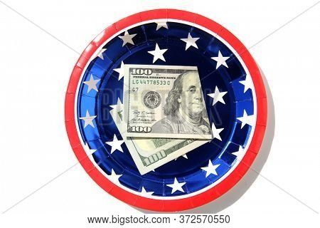 $100.00. Folded $100.00 American Bill. Cash. Cash on a patriotic red white and blue paper plate. Tip for service. Birthday Gift of cash. Paying the bill. Spare Change.
