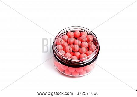 Close Up View Of Orange Boilies, Fishing Baits For Carp Isolated On White Background.