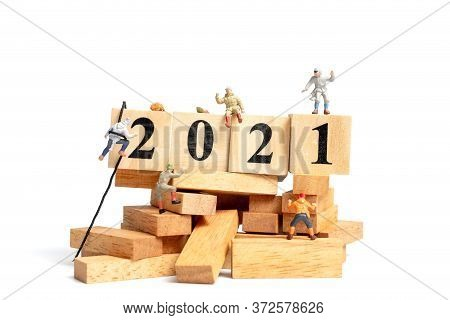 Miniature People: Climb Up On Wooden Cube With Number 2021