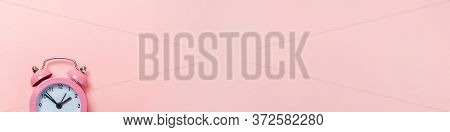 Simply Minimal Design Ringing Twin Bell Classic Alarm Clock Isolated On Pink Pastel Background. Rest