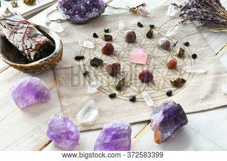 A Close Up Image Of A Self Love Crystal Grid Using The Flower Of Life Sacred Geometry Grid Cloth And