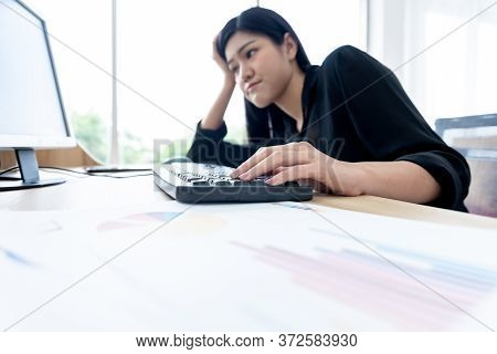 Blurred Soft Images Of Asian Businesswoman Is Working By Using A Computer With Boredom At Workplace,