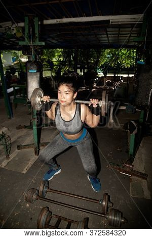 Asian Young Fitness Woman Lifting A Weight In The Gym. Fitness Woman Deadlift Barbell.