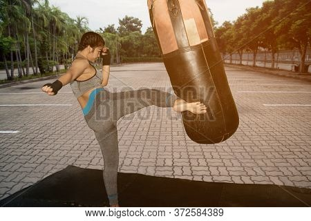 Beautiful Young Asian White Girl With Long Hair 20-30 Years Old. Practice Muay Thai Boxing By Kickin