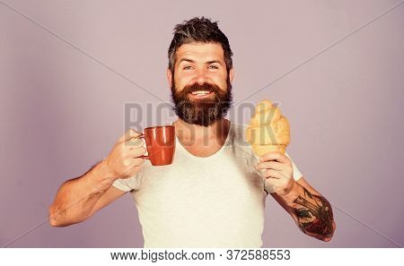 Be Healthy. Bearded Hipster Enjoy Breakfast Drink Coffee. Morning Tradition Concept. Fresh Baked Cro