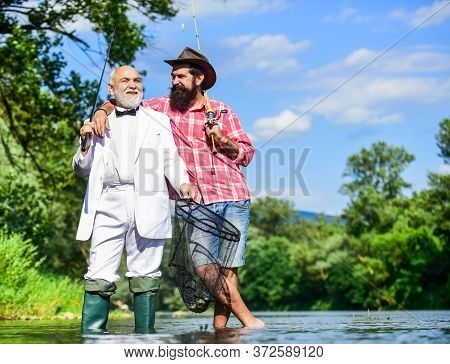 Gone Fishing. Fly Fishing Adventures. Retired Father And Mature Son With Beard. Friends Men With Fis