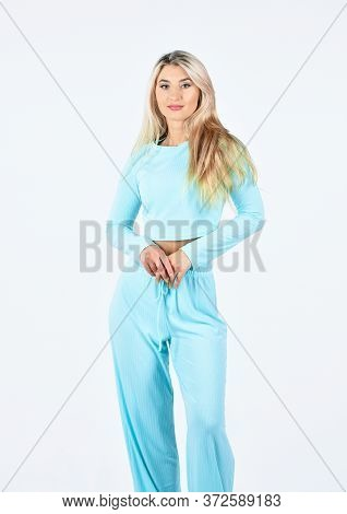 Cool And Sexy. Attractive Woman In Fashionable Sportswear. Girl In Sweatpants And Sweatshirt. Outdoo