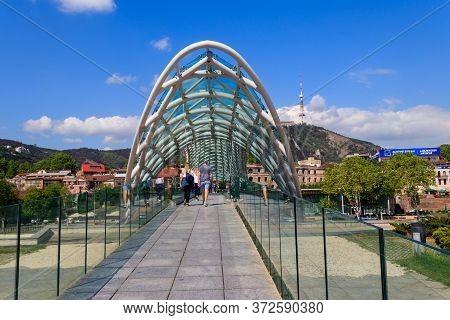 Tbilisi, Georgia - May 1, 2018: Bridge Of Peace In Tbilisi. Pedestrian Bridge Over The Kura River