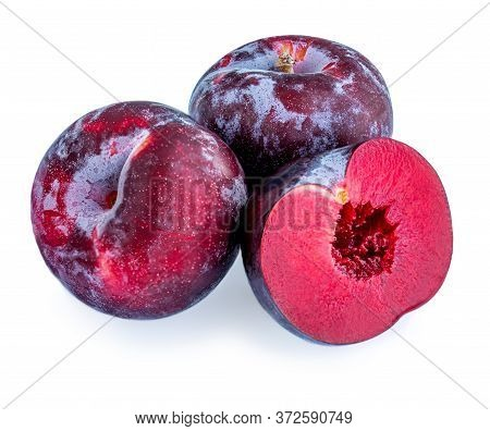 Plum Fruits Isolated On White Background. Whole And A Half Of Blue Plums Macro