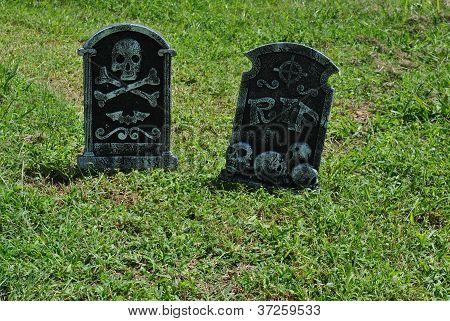 two   fake  halloween  tombsones