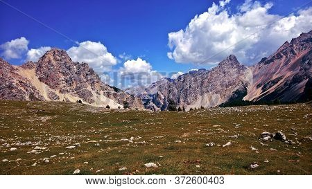 Trentino Alto - Adige, Italy - 06/15/2020: Cenic Alpine Place With Magical Dolomites Mountains In Ba